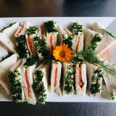 Cocktail triangle sandwiches with cold smoked salmon & dill